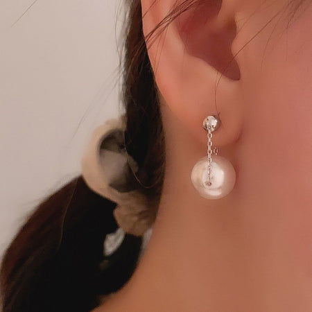 Swinging Pearl Earrings - Silver
