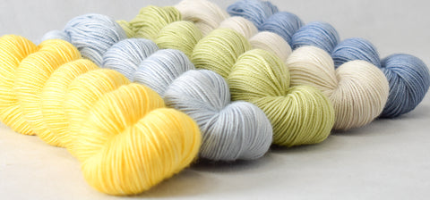 Yummy 3-Ply yarn in shades of yellows, greens, and blues
