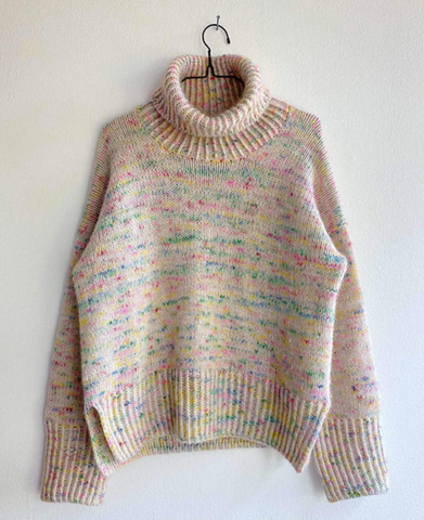 a light neutral colored sweater knit with brightly colored mohair so the sweater appears speckled with confetti