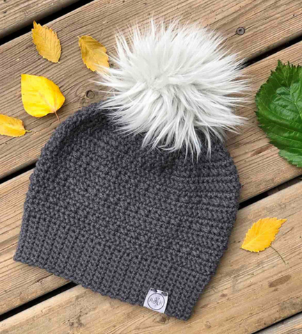 gray crocheted hat with white pompom