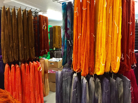 autumn-colored yarn drying in the studio