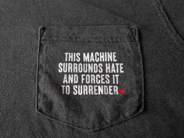 Surrounds Hate Pocket Tee