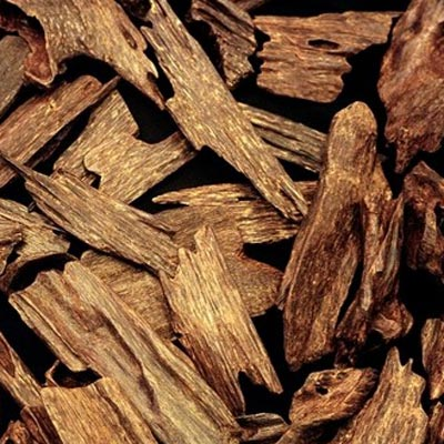 Image of wood chips used to extract Aoud scent - link to products using Aoud collection