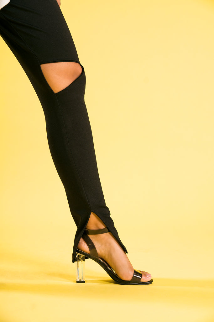 Black fitted pants with triangle cutout