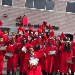 Strive International graduates in red cap and gowns
