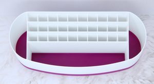 Top view of empty Cricut pen holder showing 30 slots for pens and three larger pockets shown in purple accent colour