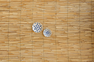 handmade ceramic set of small plates with indigo spots