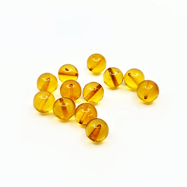 Round amber beads - Honey color