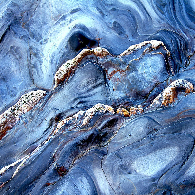 <p>Abstract image sculpted by the sea on the Gneiss veins in the cliffs of Start Bay, Devon.</p>