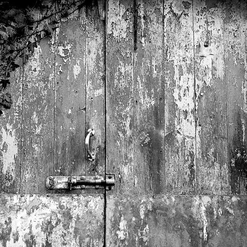 <div>Neglected buildings offer great opportunities for artists. Over the years rain, sun and wind have worn down the fabric of this hayloft door, exposing years of repainting colour on colour, to reveal its story. When the colour is removed the texture is exposed.</div>