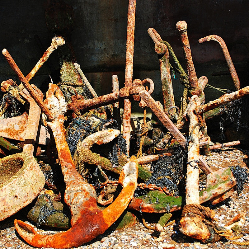 <p>Rusting anchors from a bygone life lie rusting on the banks of the River Dart, Kingswear, Devon. </p>