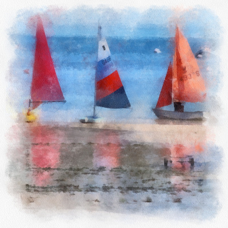 <p>Summer time at South Sands in Salcombe appear colourful masted toppers, sails reflected in the tides as they ebb and flow.</p>