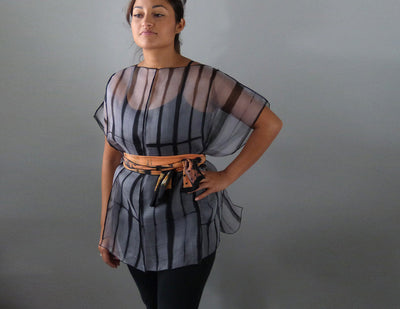 Eight panel silk shirt belted with scarf