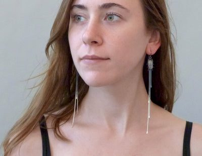 Fauna earrings on model