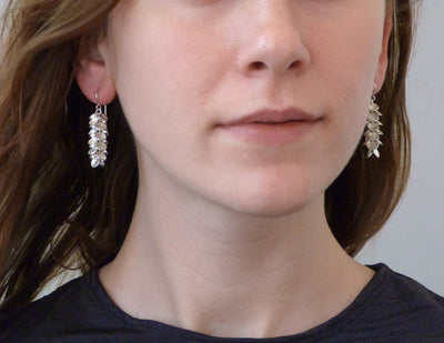 Petal earrings on model