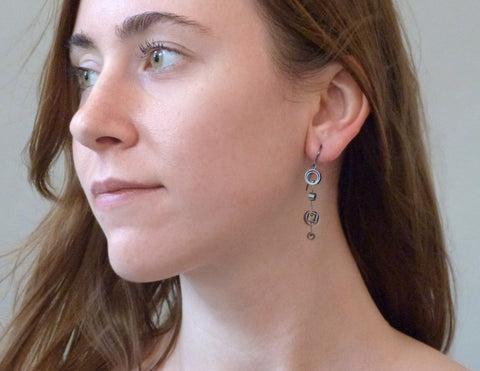 Slice oxidized earrings on model