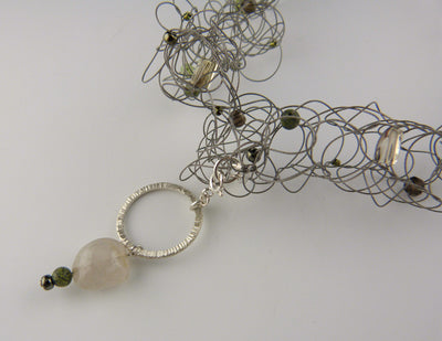 Long Knit Necklace, greens pendant detail view