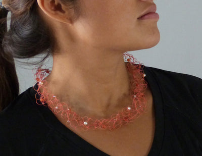 Short Knit Necklace orange on model