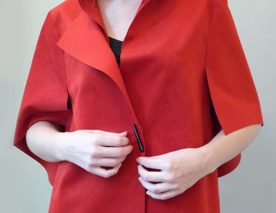 Slice Jacket, red, on model, clasp detail