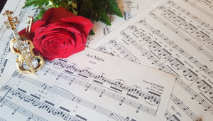Sheet music image with a flower and a golden violin