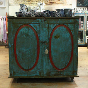 Turquoise and Red Oval Cupboard