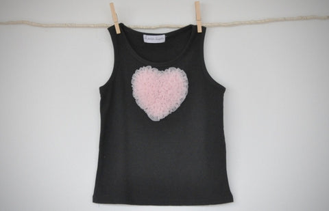 black sleeveless top with baby pink heart