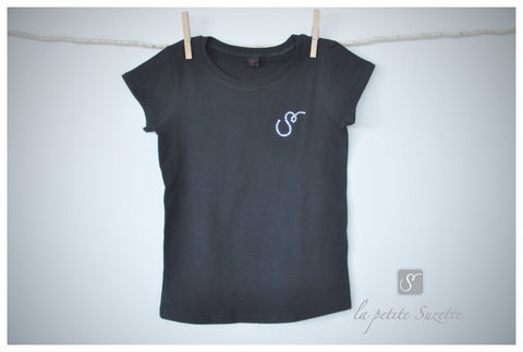black T top with glittery logo