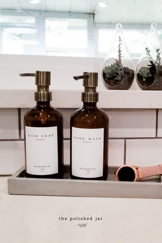 Minimalist kitchen sink counter with tray and soap glass bottle dispensers