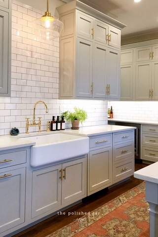 Modern farmhouse kitchen sink counter with The Polished Jar glass bottle soap dispensers