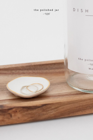 Glass Bottle Soap Dispenser and Ring Dish on a Wood Tray