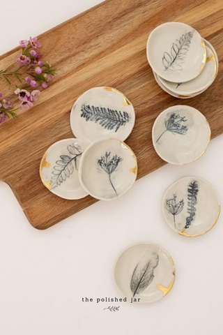 The Polished Jar Ring Dishes on a Wood Tray