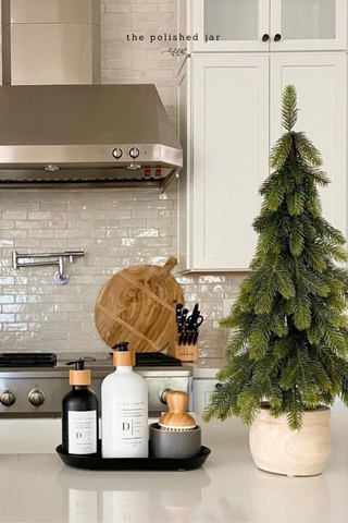 Modern kitchen counter with monogram soap and lotions bottle dispensers created by The Polished Jar