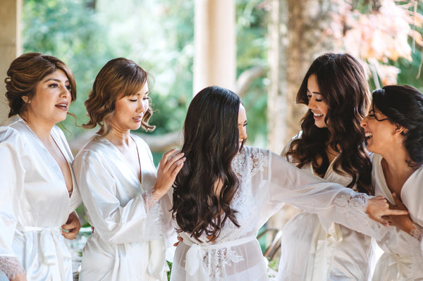 Bridal party in lace bridal robes