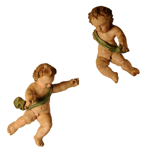 Pair  early 18th century polychromed Putti, Spanish