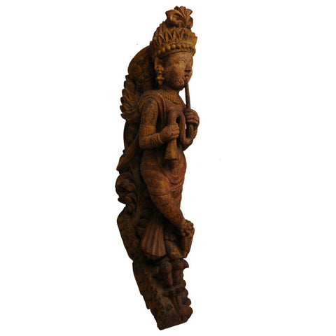 Hardwood carving of a temple musician, South India, circa 1890