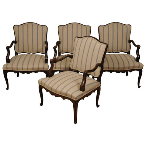 A suite of four Louis XV walnut fauteuils (open armchairs), French, mid 18th century