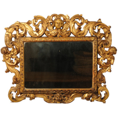 Carved giltwood Sansovino frame, now with a mirror plate, Italy 17th century
