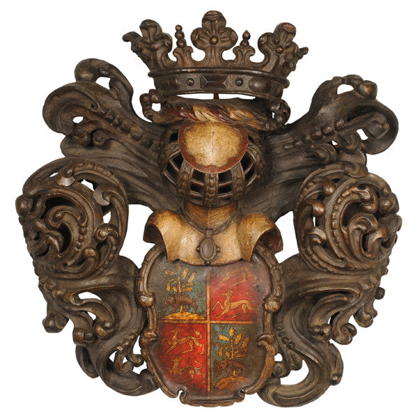 Carved wood armorial with later painted shield, French, 18th century