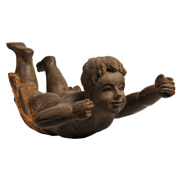 Hardwood carving of a putto in flight, Spanish Colonial, 1930s