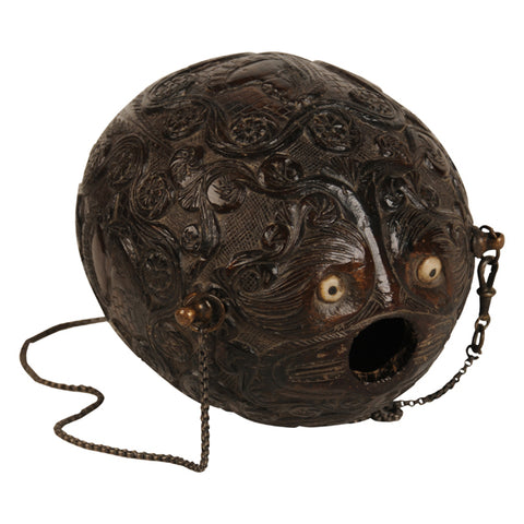 "Carved coconut powder flask ""bugbear"", Spanish Colonial, early 19th century"