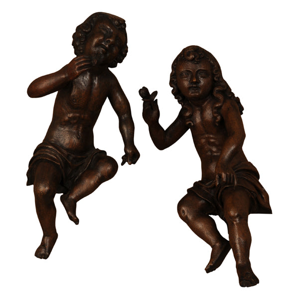 Two oak angels each holding a fig, Dutch late 17th century, Sculpture - Kate Thurlow | Gallery Forty One
