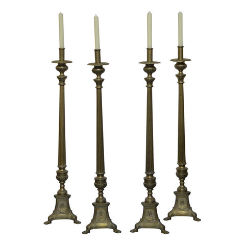 Four tall brass altar candlesticks, English circa 1910