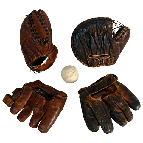 Four vintage baseball leather mitts and one ball.  USA, 20th century