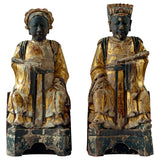 Pair seated carved wood dignitaries with gilt decoration.  China, Ming  Dynasty