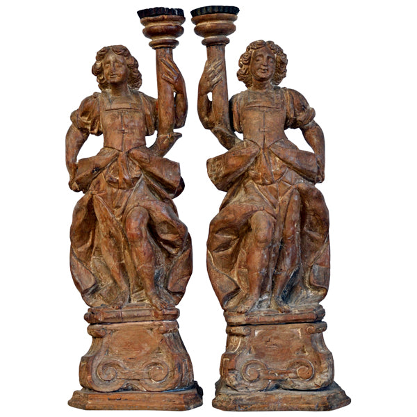 Pair limewood candlesticks in the form of angels, North Italian, early 18th century