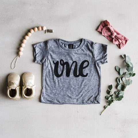 """One"" First Birthday Baby Tee - LOCAL FIXTURE"