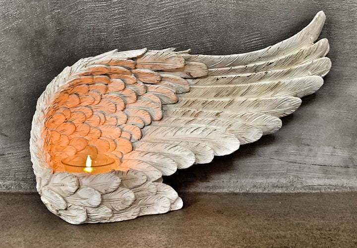 Fly away candle holder