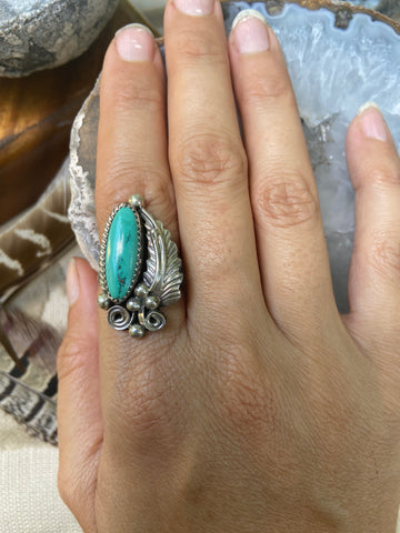 Stunning Oval Turquoise with Intricate Feather and Silver work