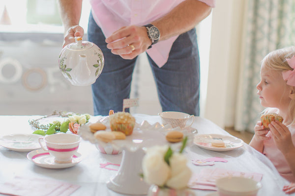 Pinkies up, toddler tea party for little girls, Daddy pouring tea.