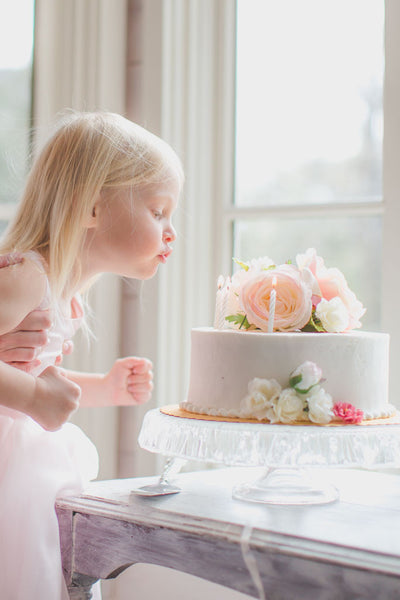Blowing out candles, Flower cake, light pink, peach, white roses and silk peonies, Tea Party Birthday Party.